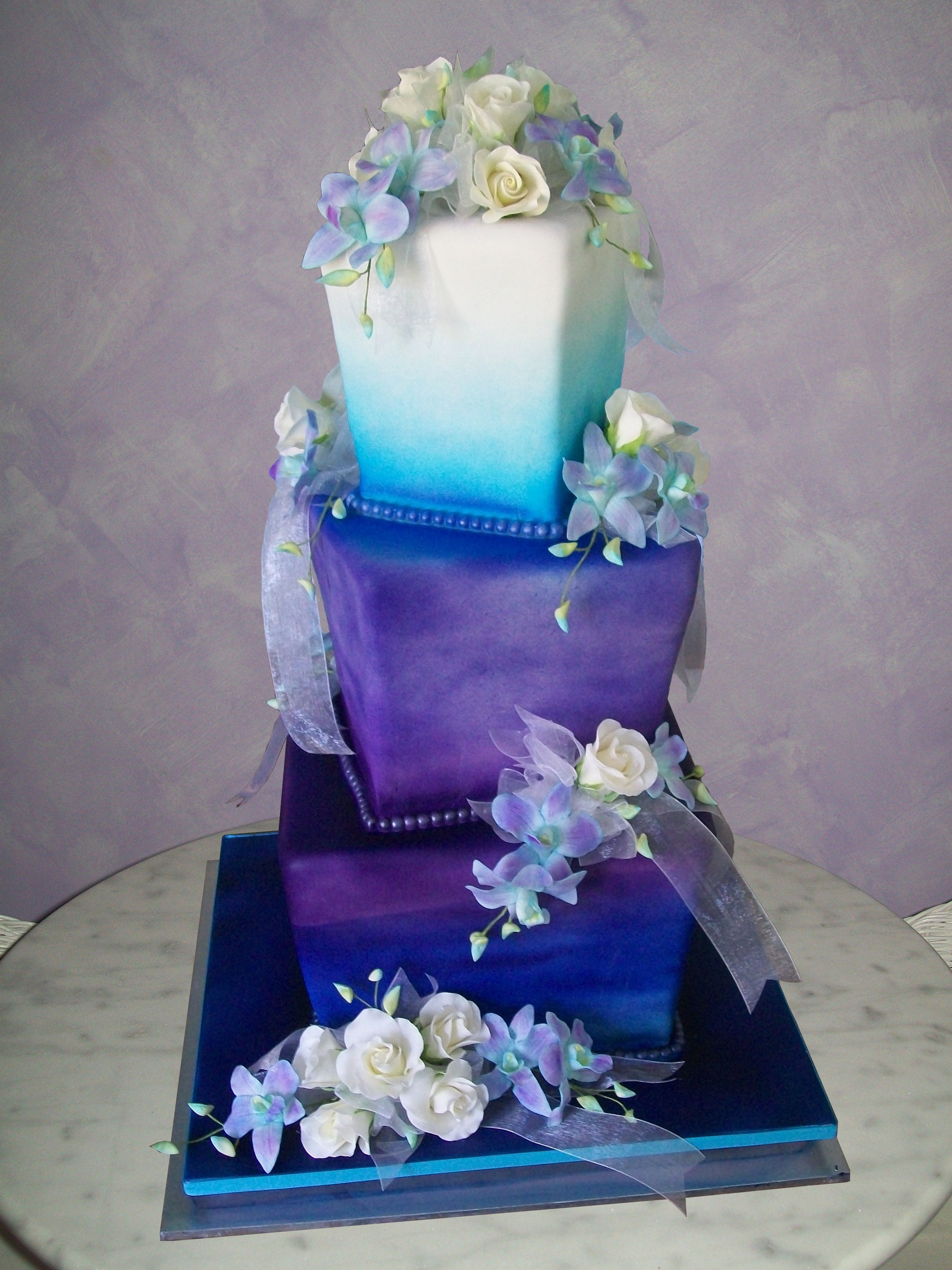 Best Purple Wedding Cakes ideas You Want Tried Yet,purple wedding cake with cupcakes,3 tier purple wedding cake,purple and black wedding cakes,purple and silver birthday cake,purple and blue wedding cake